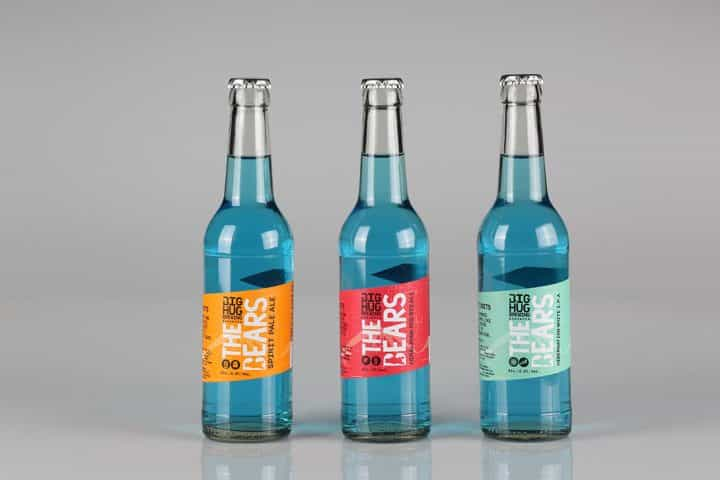 Professional bottle label printing. Three multi versioned labels on bottles.